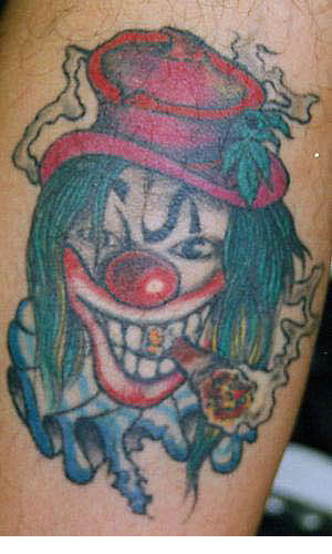Böser Clown mit Zigarre Tattoo